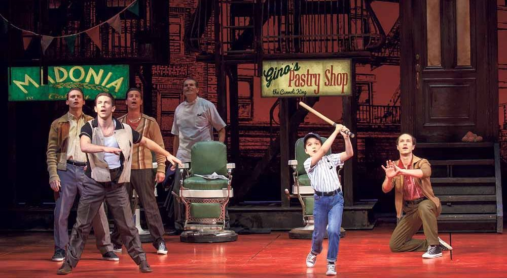 Young Calogero (Hudson Loverro) swings for the seats as A Bronx Tale cast looks on. (Photo by Joan Marcus) Theatre Owned / Operated by The Shubert Organization (Philip J. Smith: Chairman; Robert E. Wankel: President) Produced by Tommy Mottola, The Dodgers, Tribeca Productions, Evamere Entertainment, Neighborhood Films, Jeffrey Sine, Cohen Private Ventures and Grant Johnson; Produced in association with Paper Mill Playhouse (Mark S. Hoebee, Producing Artistic Director; Todd Schmidt, Managing Director); Associate Producer: Lauren Mitchell World Premiere in Millburn, New Jersey on February 14, 2016 at Paper Mill Playhouse (Mark S. Hoebee, Producing Artistic Director; Todd Schmidt, Managing Director) Book by Chazz Palminteri; Music by Alan Menken; Lyrics by Glenn Slater; Based on the play by Chazz Palminteri; Music arranged by Ron Melrose; Music orchestrated by Doug Besterman; Musical Director: Jonathan Smith Directed by Robert De Niro and Jerry Zaks; Choreographed by Sergio Trujillo; Associate Director: Stephen Edlund; Associate Choreographer: Marc Kimelman Scenic Design by Beowulf Boritt; Costume Design by William Ivey Long; Lighting Design by Howell Binkley; Sound Design by Gareth Owen; Hair and Wig Design by Paul Huntley; Makeup Design by Anne Ford-Coates; Associate Scenic Design: Jared Rutherford; Associate Costume Design: Mariah Hale; Associate Lighting Design: Ryan O'Gara; Associate Sound Design: Josh Liebert; Associate Hair and Wig Design: Giovanna Calabretta Executive Producer: Sally Campbell Morse; General Manager: Dodger Management Group; Company Manager: Miguel A. Ortiz; Associate Co. Mgr: Reeve Pierson Technical Supervisor: Hudson Theatrical Associates; Production Stage Manager: Beverly Jenkins; Stage Manager: Michael Rico Cohen Musical Supervisor: Ron Melrose; Musical Coordinator: John Miller; Conducted by Jonathan 'Smitti' Smith; Associate Conductor: John Samorian; Woodwinds: Kristy Norter and John De Simini; Trumpet/Flugel: Jami Dauber; Trombone/Tuba: Clint Sharman; Guitars: Kenny Brescia and Bernd Schoenhart; Drums: Perry Cavari;