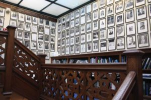 The wall of Explorer's Club presidents graces the second floor landing.
